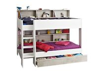 Kid's bunk bed in white - Harvey Norman 'Charlie' type with ladder and shelving.