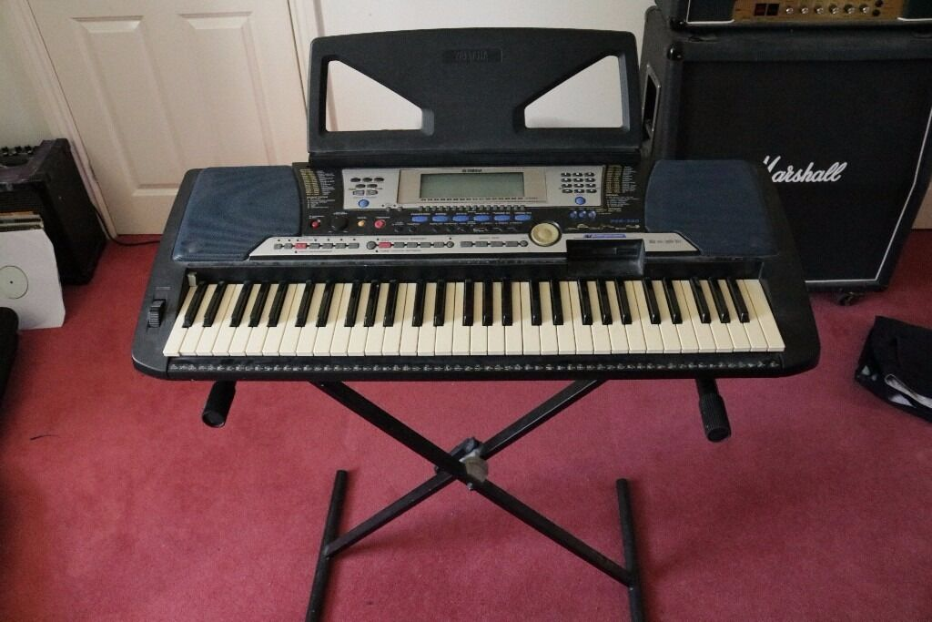Yamaha Keyboard PSR-540 with stand, foot switch and power cable.