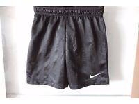 9 pairs black Nike Football Shorts. Large Boys 12/13 155-158cm
