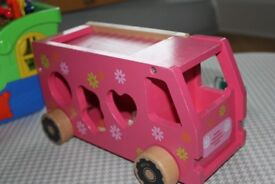 Pink wooden Shape Sorting Flower Van