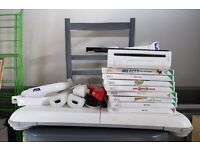 Nintendo wii fit bundle (White) with some great games - fun home entertainment!