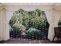 Rainbow colour origami cranes on strings to make curtain - perfect wedding decoration