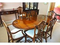 mahogany extending dining table and 8 reupholstered chairs