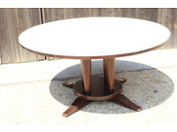 Large Round restaurant Dining Table with Padded Top for quiet fine dining.