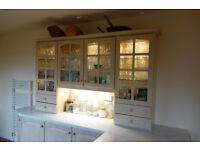 Light oak veneer kitchen units including larder fridge