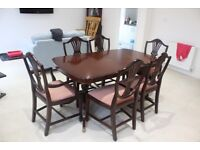 Extendable dark wood dining table and six chairs.