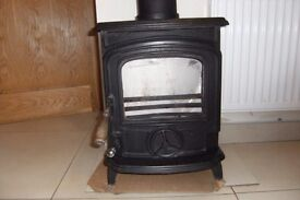 Stanley multi fuel cast iron stove,used,and in good condition and working perfectly.H21inW16inD14in.