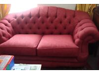RED CHESTERFIELD THREE PIECE SUITE. Good condition.
