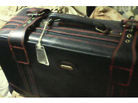 Small leatherette suitcase by Shalamex