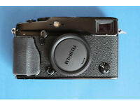 Fuji X-Pro1 camera with 35mm/1.4 lens, including original box and accessories