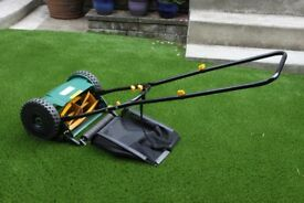 30cm (12 inch) hand-push cylinder lawnmower with grass catcher. Nearly new. Ideal for small lawns.