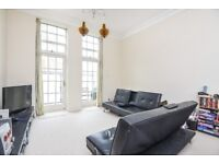 A two bedroom split-level apartment in this popular gated factory conversion in Southfields.