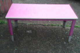 Metal framed table with adjustable legs,.