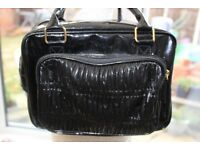 Small black bag (could be used as a make up / toiletry bag)