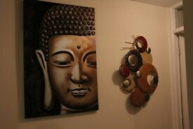 Large Buddha Canvas and Metal Circular shapes.