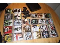 Playstations 3 slim model + 25 great games + 3 controllers (no wires)