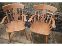 Two beech pine coloured carver chairs in vgc.