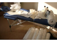 MASSAGE COUCH, with lots of extras. Couch roll, covers, oil, bowls etc