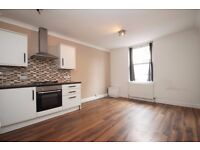 A well-presented unfurnished converted ground floor flat in w