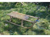 Vintage wooden sledge toboggan with metal runners