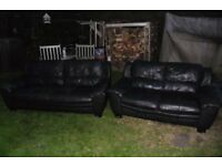 2 black leather sofa's FREE