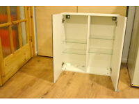 White cabinet with mirror doors and internal shelves
