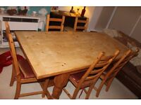 Large solid wood farmhouse table and chairs