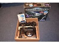 sega mega driver console + sonic games, +2 controllers . in used good condition. working fine .