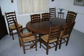 Solid oak dining table with 8 oak ladder back chairs