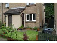 Delightful 2 bedroom UNFURNISHED lower villa (ground floor flat) with lovely gardens back and front