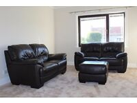 Pair of two seater brown leather sofas and stool