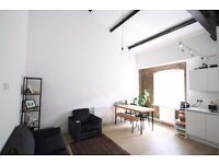 2 bed furnished flat, exposed brickwork, canal views, warehouse conversion, concierge, walk to DLR