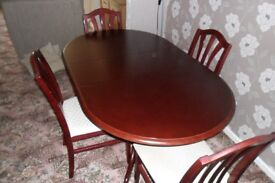 mahogany table,four chairs,sideboard and glass fronted cabinet fifty pounds or offers