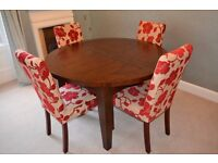 Circular extending dining table and chairs - can deliver
