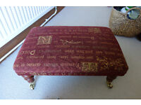 Footstool in Crimson in good condition.