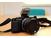 Olympus Pen E-PL5 with two lenses under 2k shutter count.