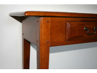 Colonial Teak Table with two drawers and slender legs.