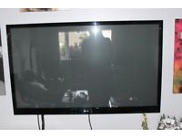 LG 55 INCH Active 3D flat screen television including 3 pairs of active glasses