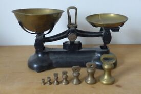 Vintage black iron weighing scales, made by the Libra Scale Co, with 7 brass imperial weights.