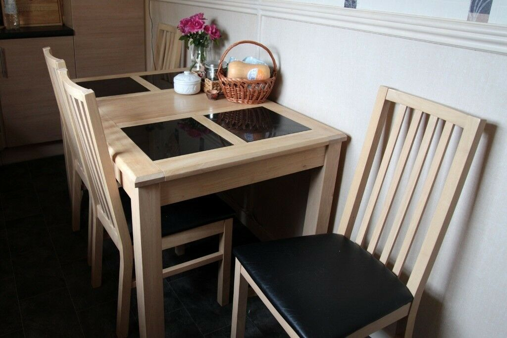 Solid oak dining table and 4 chairs.