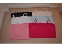 A bundle of maternity and breastfeeding clothes, size 10-12