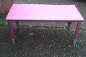 Pink metal table with adjustable legs