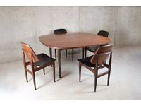 1970's mid century teak dining table and 4 black vinyl upholstered chairs
