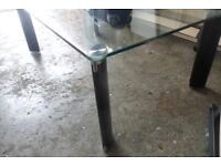 Coffee table - glass top, black legs