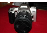 MINOTLA 404SI DYNAX 35MM CAMREA WITH 2 LENSES. THE CAMERA IN GREAT CONDITION
