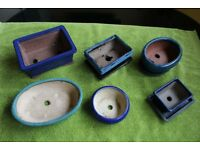 Bonsai bowls, trays, wire and information books - 17 items in total