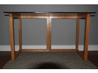 Habitat: red glass top office desk with wooden tressles