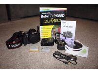 Canon EOS 500D Digital SLR camera body with accessories