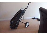 Golf clubs x 8 Howson bag and golf trolley
