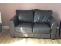 Brown leather two seated sofa free